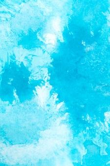 Splash aquarelle sur la composition de la texture du papier
