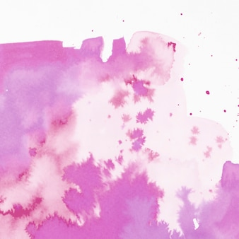 Splash aquarelle rose abstraite sur fond blanc