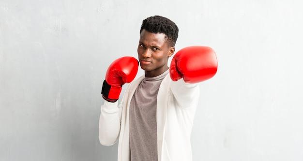 Sportif afro-américain avec des gants de boxe