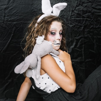 Sppoky girl with rabbit making funny face