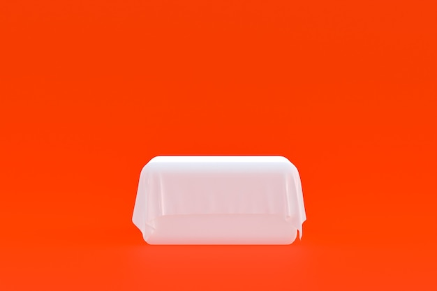 Stand de produit, podium minimal sur fond orange pour la présentation de produits cosmétiques.