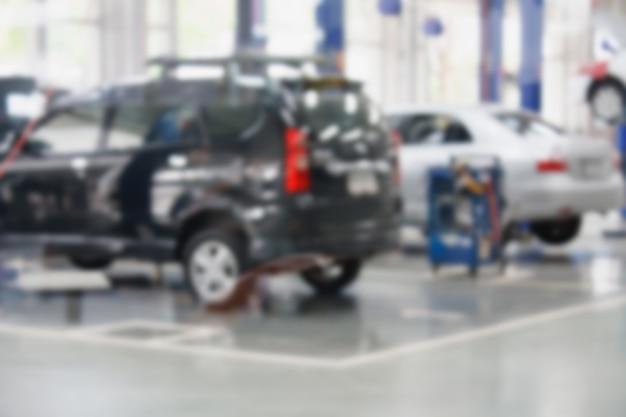 Station-service de réparation automobile arrière-plan flou