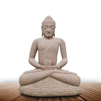 Statue de bouddha sur fond blanc