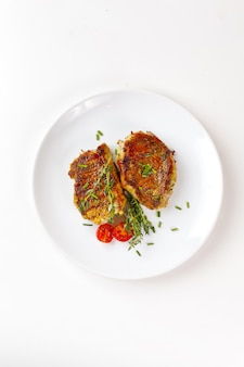 Steaks de viande de porc rôtis