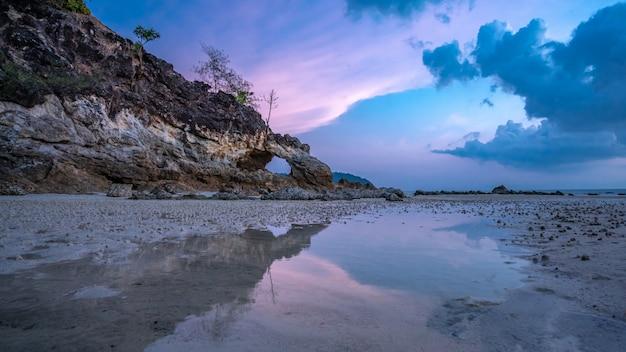 Stone cave sea island
