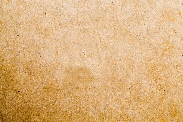 Structure de carton jaune qui est utilisé pour la décoration ou la production de produits en papier ou en carton, gros plan de carton ordinaire