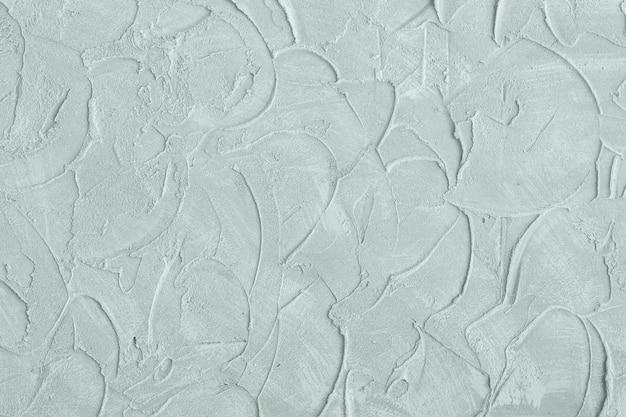 Stuc en relief sur le fond du mur. couleur menthe. fermer