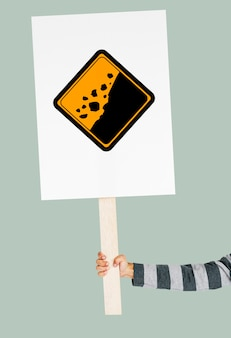 Studio shoot holding banner avec rockfall beware sign