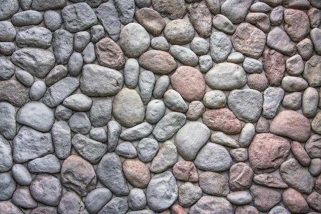 Style moderne de construction de beau mur de pierre ovale avec du ciment