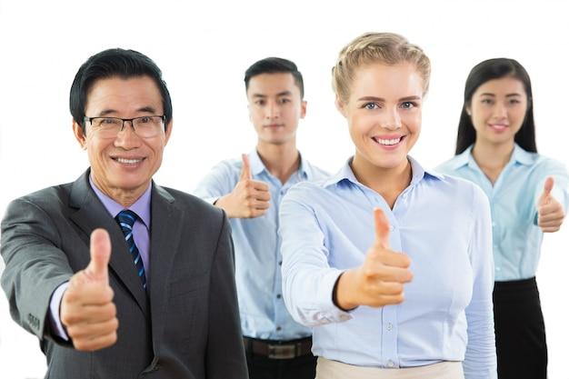 Succès sourire business team affichage thumbs up