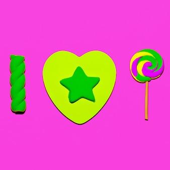 Sucette et guimauves. amoureux des bonbons. art plat