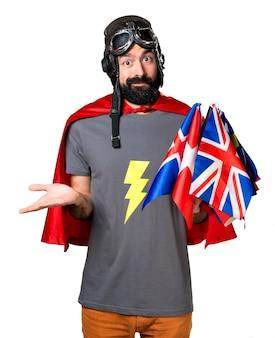 Super-héros avec beaucoup de drapeaux faisant un geste sans importance