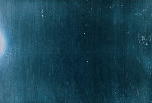 Superposition rayée. texture grunge. surface de film ancien bleu avec motif de bruit de particules de saleté de poussière. effet de verre fané foncé pour l'édition de photos.