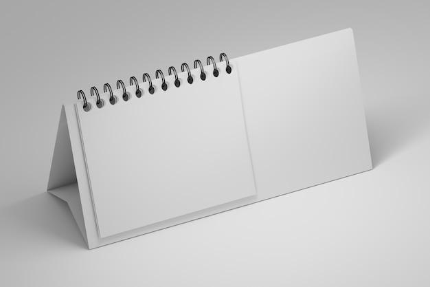 Support de papier vierge de table de bureau avec support de feuilles de papier en spirale sur blanc