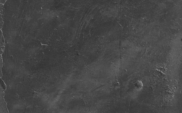 Surface accidenté de ciment grungy noir