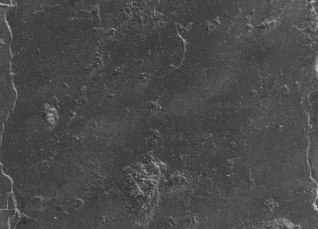 Surface accidenté de ciment noir cahoteuse