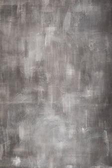 Surface de béton de mur de pierre grise comme texture de fond