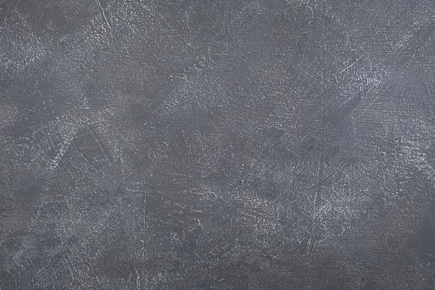 Surface de béton de mur de pierre grise ou grise comme arrière-plan, texture peinte