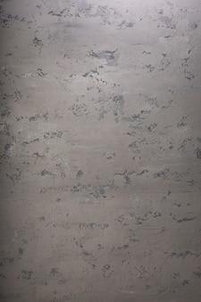 Surface de béton de mur de pierre grise ou grise comme texture de fond