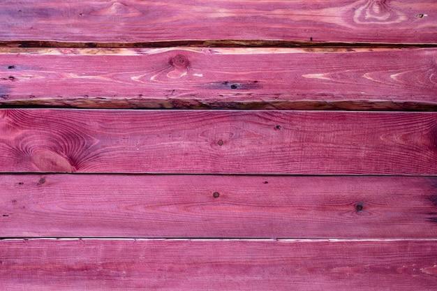 Surface en bois de couleur rose, texture ou fond