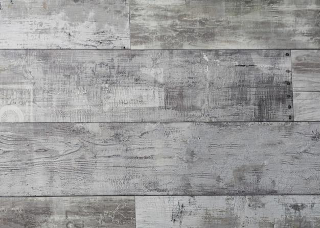 Surface en bois patiné rustique avec de longues planches alignées