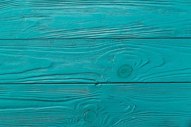 Surface en bois peinte en bleu avec des nœuds