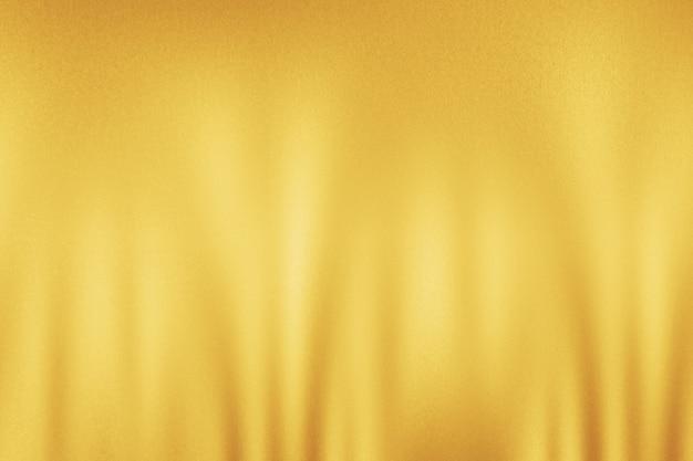 Surface brillante dorée avec réflexion de la lumière