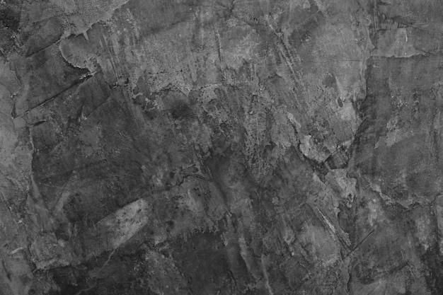 Surface de ciment dans les tons sombres.