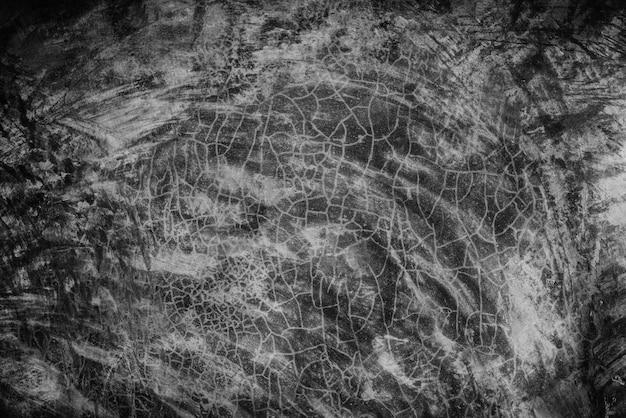 Surface de ciment gris foncé vieux noir pour le fond. textures de mur en béton.