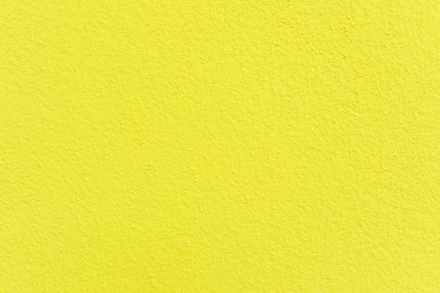 Surface de ciment jaune pour le fond, mur de béton.