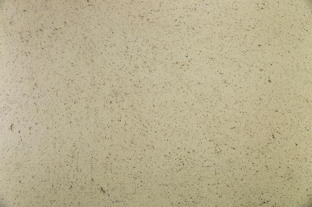 Surface de ciment avec des taches