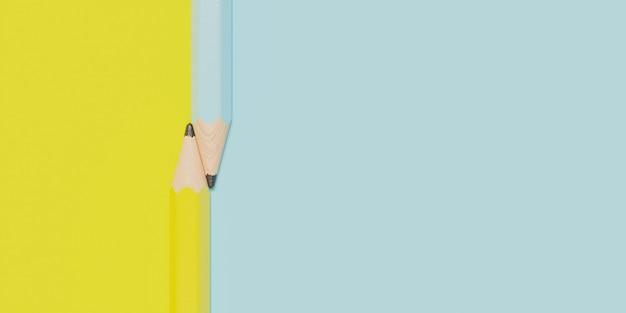 Surface avec deux crayons croisés et couleurs séparées