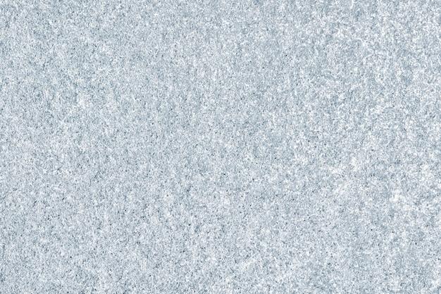 Surface du mur en béton grossièrement peint