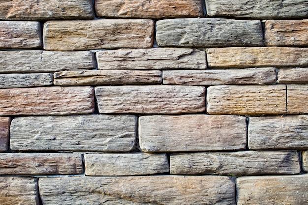 Surface du mur avec pierre solide brute