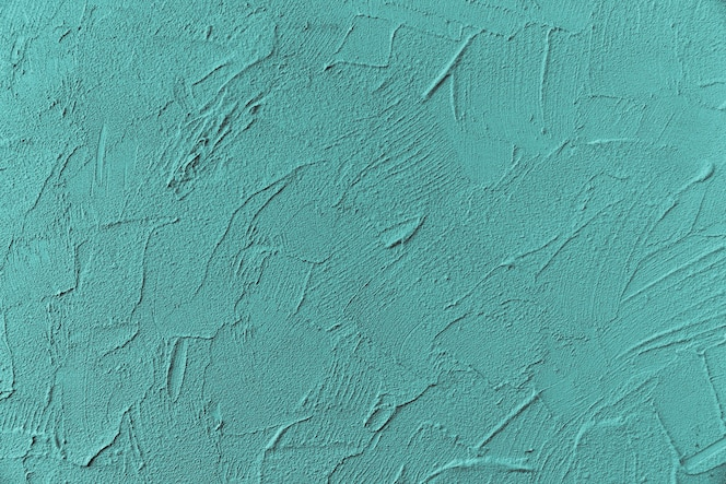Surface du mur rugueux peint en bleu