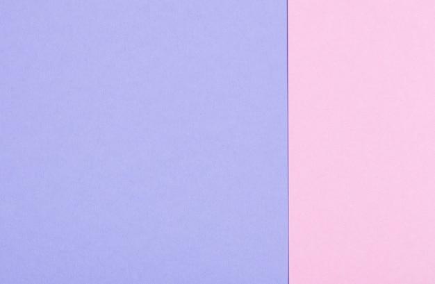Surface de feuilles de papier pastel rose et violet
