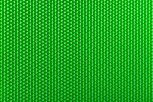 Surface futuriste. fond de nid d'abeille géométrique vert clair. modèle.
