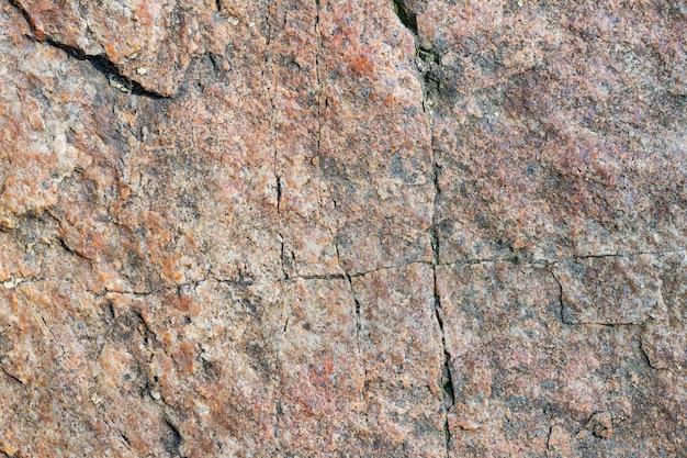 Surface de granit. texture de pierre de granit. surface de pierre naturelle fissurée. espace de copie
