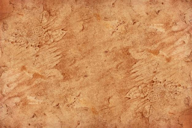 Surface de grunge vieux papier brun. texture de couleur café liquide abstraite.