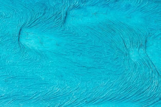 Surface inégalement peinte de couleur bleue avec des fissures
