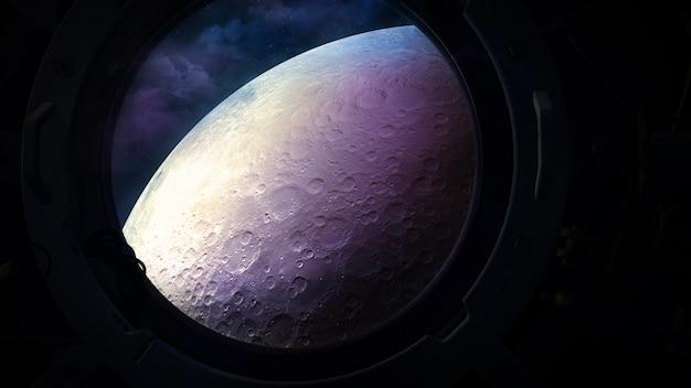 La surface de la lune depuis le hublot d'un vaisseau spatial