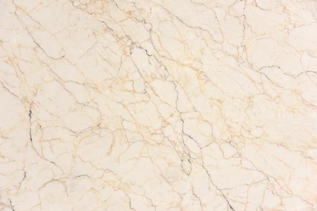 Surface en marbre veiné beige poli