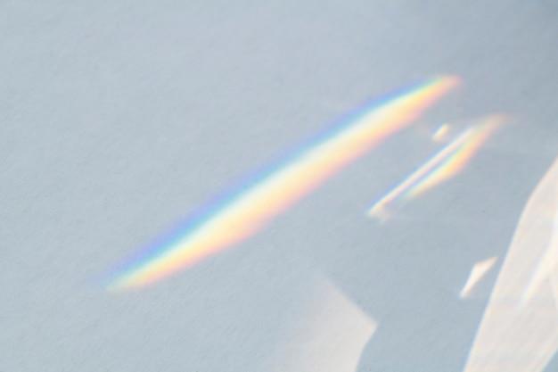 Surface métallique défocalisée grise avec reflet arc-en-ciel