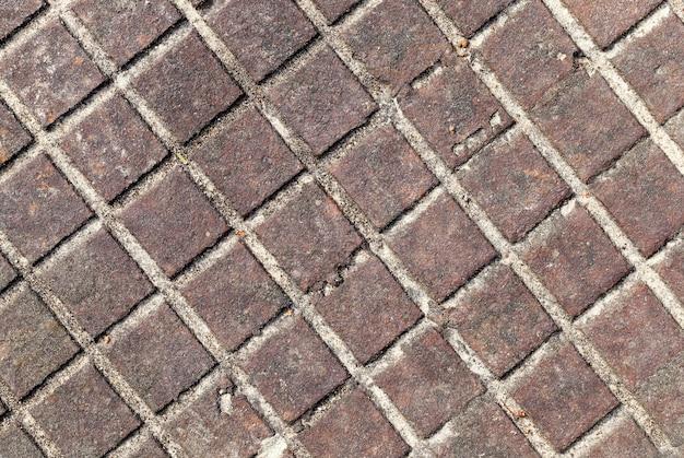 Surface métallique rouillée ancienne au carré, fond abstrait