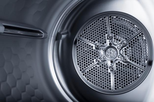 Surface métallique texturée à l'intérieur d'une laveuse ou d'une sécheuse