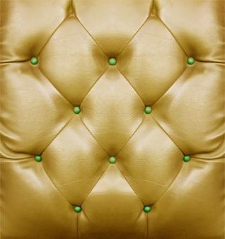 Surface de motif de canapé doré pour le fond