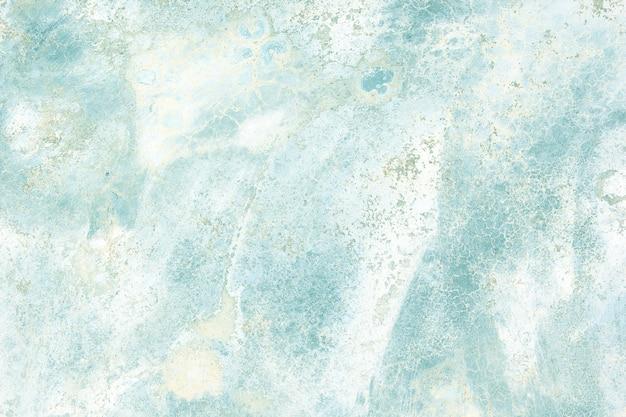 La surface à motifs en marbre est colorée et douce