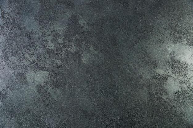 Surface de mur en ciment avec aspect texturé