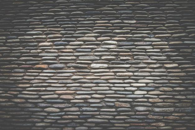 Surface de mur en pierre réelle, filtre retro foncé