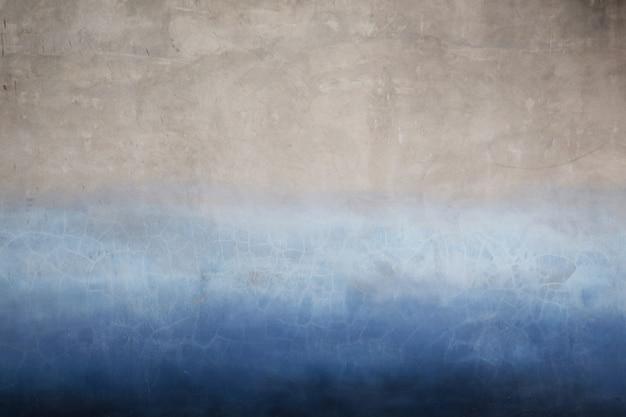 Surface murale ancienne en deux tons de bleu et de gris.